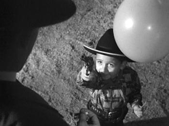 strangers-on-a-train-cowboy-kid